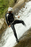 Canyoning Guide Descending A Class Three Waterfall Royalty Free Stock Photos