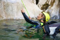 Woman canyoning in Pyrenees, Spain. Stock Photo