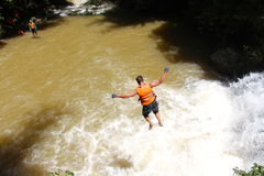 Canyoning male jumping into canyon Vietnam Stock Image