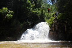 Canyoning male jumping into canyon Vietnam Stock Photos