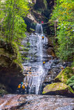 Canyoning in waterfall at blue mountians Stock Photos