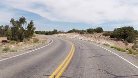 Canyonlands 5. Driving around a bend through the wide open desert stock video footage