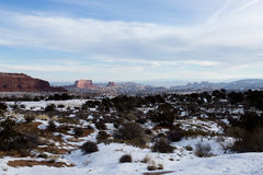 Canyonlands After Fresh Snow. Fresh snowfall on small shrubs and unique rock formations in Canyonlands National Park Utah entrance Stock Photography
