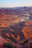 Canyonlands Vista from Green River Overlook. Looking down on rugged desert terrain in afternoon light with cliffs, mesas and buttes in the background royalty free stock photography