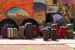 Canyons in the State of Utah. Tourists` luggage at the bus depar. Zion Park, Utah, USA - June 03, 2015: Tourists` luggage ready to be boarded at the bus Stock Photo