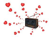 Canzoni di amore che giocano su una bella vecchia radio Fotografie Stock
