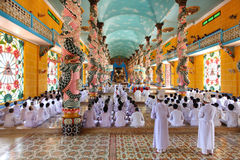 Cao Dai temple in Vietnam, prayer time Royalty Free Stock Photography