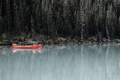 Caoes. Red canoes on a lake in Alberta Stock Images