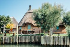 Caorle, Venice lagoon Italy. A typical Casone. Caorle, Venice lagoon Italy. A typical `casone` with thatched roof once used by fishermen. Today they are used as stock photography
