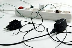 Caos alrededor del cable de extensión Fotografía de archivo