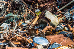 Caos del Consumerist de ferroso en una lavadora fotos de archivo