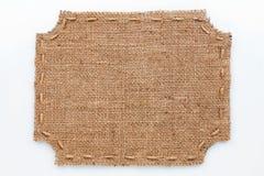 Capítulo de la arpillera, mentiras en un fondo blanco imagen de archivo