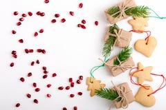 Capítulo de las galletas de la Navidad, de las semillas de la granada y de los regalos hechos en casa fotografía de archivo