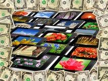 Capítulo de los dólares en las muchas tabletas Imagenes de archivo