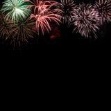 Capítulo de los fuegos artificiales coloridos del día de fiesta con el espacio Foto de archivo libre de regalías