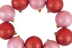Capítulo hecho de las chucherías rojas y rosadas de la Navidad Foto de archivo