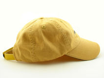 Cap. Yellow sports cap isolated over white background Stock Photos