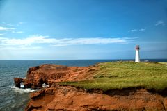 Cap aux meules Lighthouse also called Borgot lighthouse. In Magdalen island in Quebec, Canada during summer season Royalty Free Stock Photos