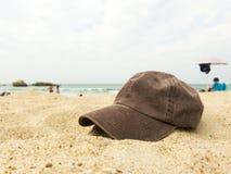 Cap on a beach Royalty Free Stock Photo