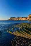 Cap bon ami. Low angle shoot of Cap Bon Ami with some stratified rock in foreground Stock Images