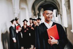 Cap. Campus. Guy. Mantle. Cheerful. Celebration royalty free stock images