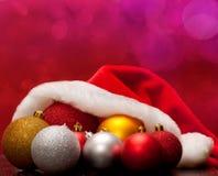 Cap and Christmas balls Stock Photography