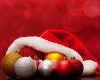 Cap and Christmas balls Royalty Free Stock Image