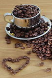 Cap of coffee beans. Coffee beans and cap of coffee beans royalty free stock images