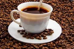 Cap of coffee with cofee beans. Cap of coffee with spoon and coffee beans Stock Image