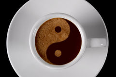 Cup of coffee. Coffee cup with yin yang sign in cream Stock Image