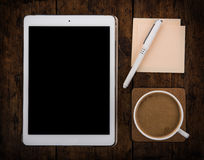 Cap of coffee and tablet pc and pen Stock Images
