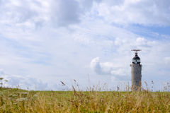 CAP CRIS-NEZ, FRANCE - JULY 21 - Lighthouse on field with yellow grass. In summer day royalty free stock photos