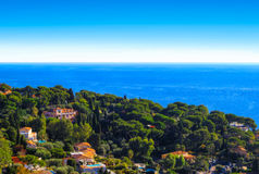 Cap d`Ail villas in the French Riviera and the Mediterranean sea. Prestigious properties on a hill facing the sea in the beautiful French Riviera Royalty Free Stock Photos