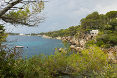 Cap d´Antibes le Sentier du Littoral French Riviera. The view from a path along the Mediterranean Sea at Cap d´Antibes, France, a cloudy day, rainclouds stock image