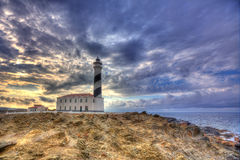 Cap de Favaritx sunset lighthouse cape in Mahon Stock Image