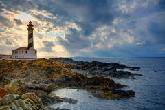 Cap de Favaritx sunset lighthouse cape in Mahon. At Balearic Islands of Spain Stock Photos