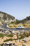 CAP DE FORMENTOR, MALLORCA - 29 JULY 2015. Cars driving alond th. Car on twisty mountain Road Stock Images