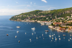 Cap de Nice and Villefranche-sur-Mer on French Riviera. Coastal aerial view of Cap de Nice and medieval town Villefranche-sur-Mer on scenic French Riviera with Royalty Free Stock Photography