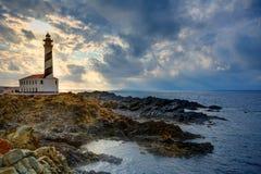 Cap de phare de coucher du soleil de Cap de Favaritx dans Mahon Photos stock