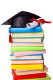 Cap and diploma on top of stack of books Stock Image
