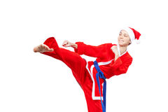 In a cap and dressed Santa Claus athlete beats blow leg Royalty Free Stock Photos