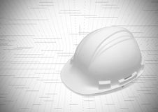 Cap of engineer color white on plan. Safety first Royalty Free Stock Images