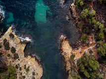 Cap falco beach in Majorca Island. Spain. Cap falco beach with turquoise green transparent water and rocky coast, view directly from above. Aerial drone royalty free stock image