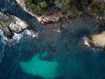 Cap falco beach in Mallorca. Spain. Cap falco beach with turquoise green transparent water and rocky coast, view directly from above. Aerial drone photography stock photo
