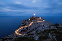 Cap Formentor car lights at night. Light rails on the street to Cap Formentor lighthouse at the northern end of Mallorca Stock Photo