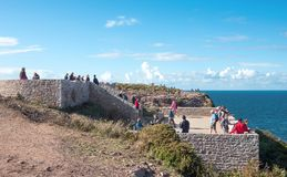 Landscapes and architectures of Brittany. Cap Frehel, France -August8, 2017: People on the ramparts of the cape looking at the sea landscape Royalty Free Stock Photos