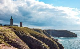 Landscapes and architectures of Brittany. Cap Frehel, France, view of the old and new lighthouse on the cliffs of the Emerald cosat Royalty Free Stock Photo