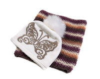 Cap with fur pompom butterfly pattern and a scarf. Isolate on white Royalty Free Stock Photography