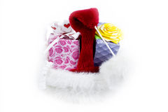 Cap and gifts. Isolated cap and gifts on a white background Stock Photo
