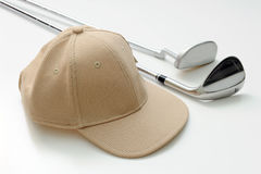 Cap and golf club Royalty Free Stock Photo